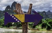 stock photo of luka  - Bosnia and Herzegovina wooden sign with a river on background  - JPG
