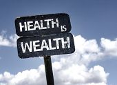 Health is Wealth sign with clouds and sky background