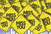 Miss You written on multiple road sign