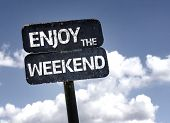 image of text cloud  - Enjoy the Weekend sign with clouds and sky background  - JPG