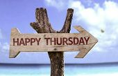 Happy Thursday sign with a beach on background