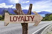 Loyalty wooden sign with a street background