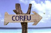 Corfu wooden sign with a beach on background