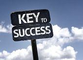 Key to Success sign with clouds and sky background