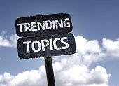 Trending Topics sign with clouds and sky background