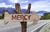 Mercy wooden sign with a street background
