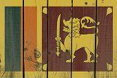 stock photo of sinhala  - Sri Lanka flag on wooden background - JPG