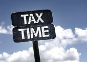 Tax Time sign with clouds and sky background