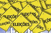 """image of election campaign  - """"Eleicoes"""" (In portuguese: Elections) written on multiple road sign  - JPG"""
