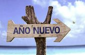 New Year (In Spanish) sign with a beach on background