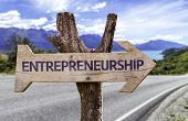 Entrepreneurship wooden sign with a street background