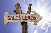 Sales Leads sign with a beautiful day on background