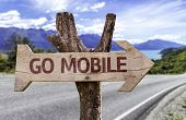 Go Mobile wooden sign with a landscape on background