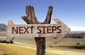 Next Steps wooden sign with a desert background