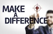 Business man pointing to transparent board with text: Make a Difference