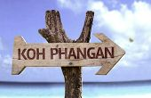 Kog Phangan wooden sign with a beach on background