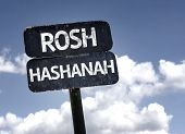 Rosh Hashanah sign with clouds and sky background