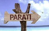 Parati wooden sign with a beach on background