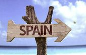 Spain wooden sign with a beach on background