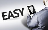 Business man with the text Easy in a concept image