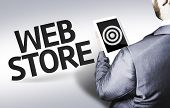 Business man with the text Web Store in a concept image
