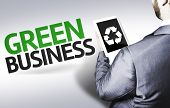 Business man with the text Green Business in a concept image