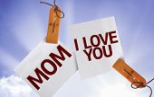 Mom I Love You on Paper Note on sky background