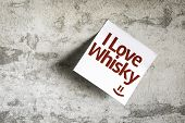 I Love Whisky on Paper Note with texture background