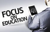 Business man with the text Focus on Education in a concept image