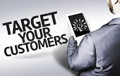 Business man with the text Target your Customers in a concept image