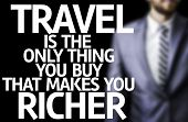 Travel is The Only Thing you Buy That Makes you Richer written on a board with a business man on background
