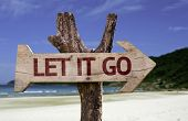 image of vibrator  - Let It Go wooden sign with a beach on background - JPG