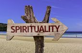 Spirituality wooden sign with a beach on background