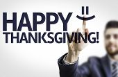 Business man pointing to transparent board with text: Happy Thanksgiving