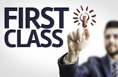 Business man pointing to transparent board with text: First Class