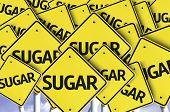 Sugar written on multiple road sign