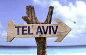 Tel Aviv wooden sign with a beach on background