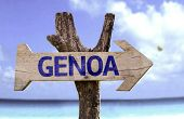 Genoa wooden sign with a beach on background