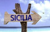 Sicily (In Italian) wooden sign with a beach on background