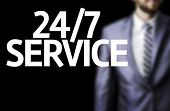 Business man with the text 24/7 Service in a concept image