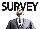 Business man with the text Survey in a concept image
