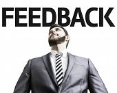 Business man with the text Feedback in a concept image
