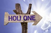Holi One wooden sign on a beautiful day