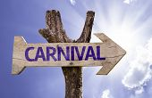 Carnival wooden sign on a beautiful day