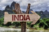 India wooden sign with agricultural background