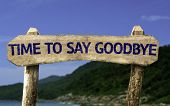 Time To Say Goodbye wooden sign with a beach on background