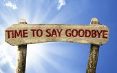 stock photo of say goodbye  - Time To Say Goodbye wooden sign on a beautiful day - JPG