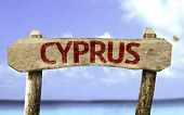 Cyprus wooden sign with a beach on background