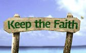 Keep your Faith wooden sign with a beach on background