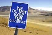 We Do Not Exist for Ourselves sign with a desert background